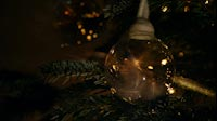 Glass Christmas Ball In Christmas Tree Close Up