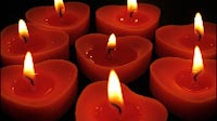 Romantic Heart Shaped Candles All Burning
