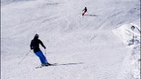 Skiers On Black Piste