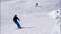 Skiers On Black Piste