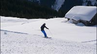 Skiers Passing Camera Sideways