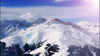 Snow Mountains With Clouds And Sun