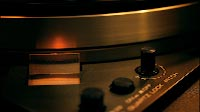 Vinyl Record Spinning On Vintage Turntable Close Up 1